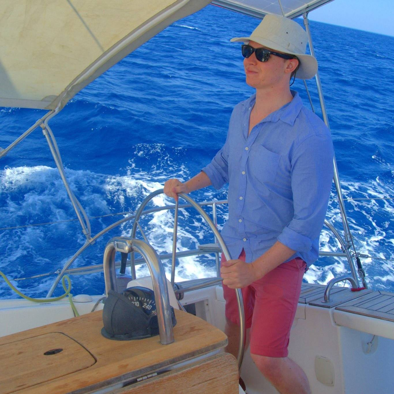 Photograph of Richard sailing somewhere sunny